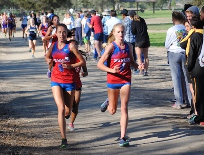 San Marcos' Erica Schroeder, left, and Natalie McClure finished first and second at the county championships.