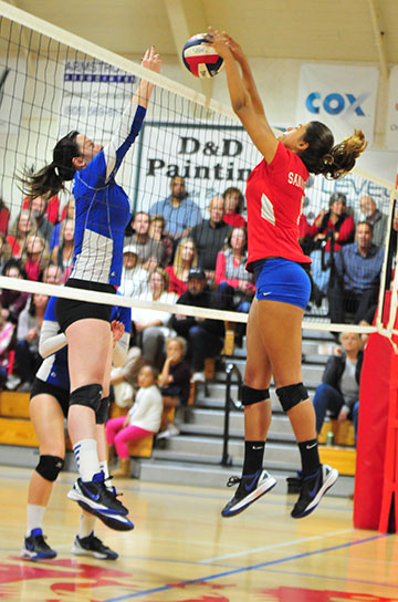 Gabi Peoples wins a ball at the net against Agoura.