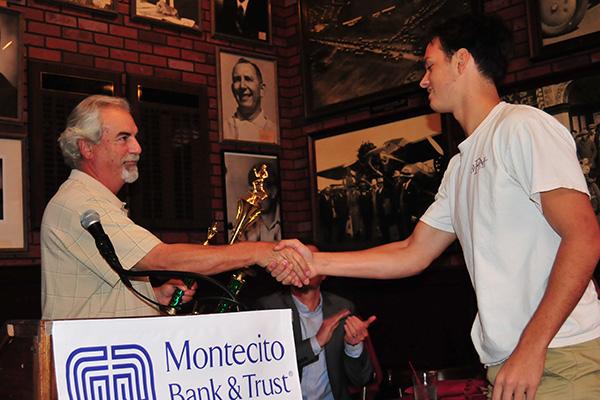Brent Peus of Santa Barbara High receives the Gary Blades Memorial Big Game MVP Trophy from award sponsor Mike Rabe