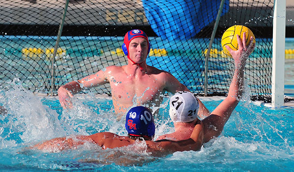 San Marcos goalie Jack Palmer waits for a shot as defender Felipe Carsalade harasses Mira Costa's Finn Pardon. (John Dvorak/Presidio Sports Photo)
