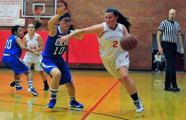 Bishop Diego's Kylie Koeper drives toward the basket against Cate.