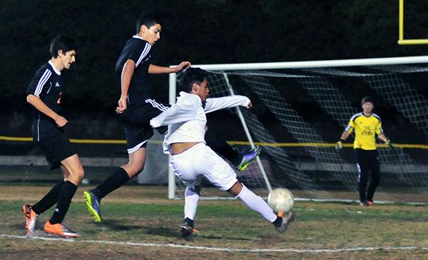 Santa Barbara High's Brandon Garcia takes a shot in Friday's game. (John Dvorak/Presidio Sports Photos)