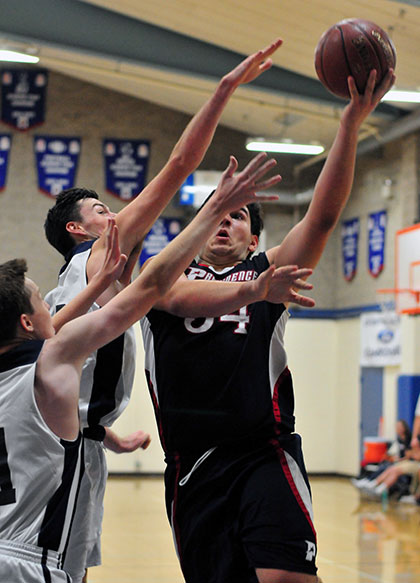 Providence's Gianni Madrigal drives to the hoop against Laguna Blanca. Madrigal had 14 points. (John Dvorak/Presidio Sports Photos)