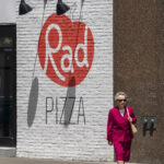 Cool looking lady walking past Rad Pizza