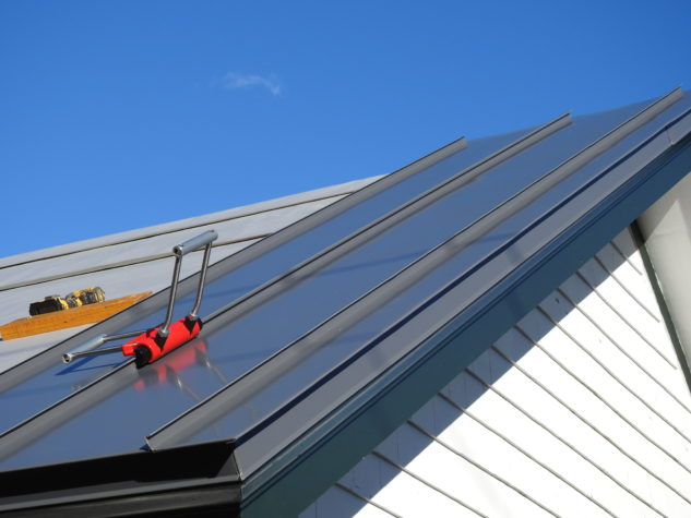 A hand seamer is used to install INroof.solar standing seam metal roofing panels