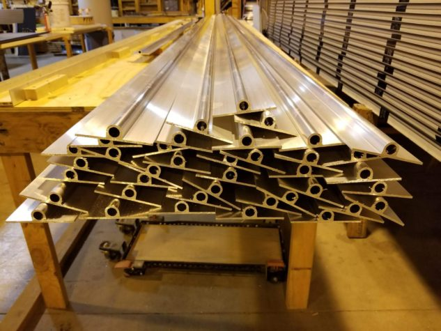 An end view of a pile of INroof.solar fin pipes before installation.