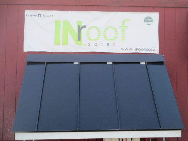 An INroof.solar banner over an INroof.solar awning at the INroof.solar manufacturing facility