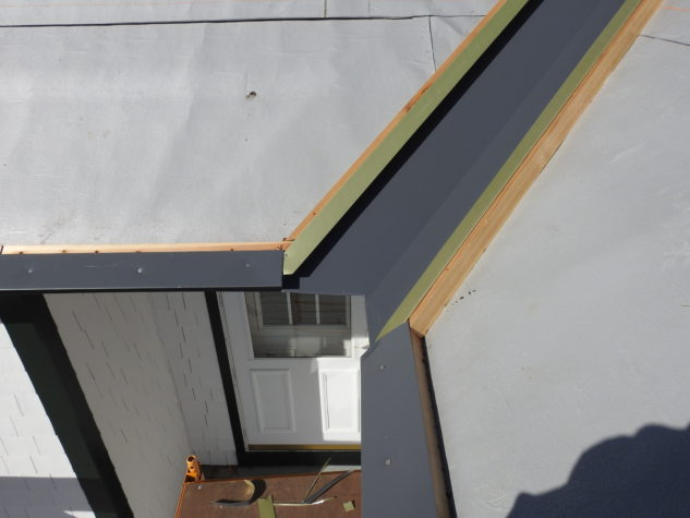 A recessed valley during an INroof.solar standing seam metal roofing installation.