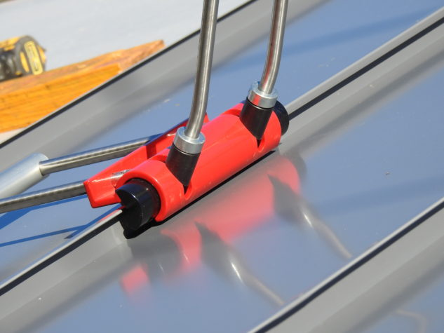 A single locking tool is used to secure panels to one another during the installation of standing seam metal roofing.
