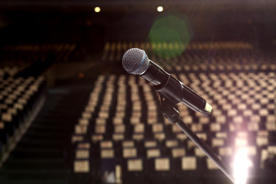 microphone on the stage and empty hall during the rehearsal