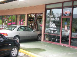 car crashed into store contrctor
