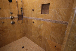 basement shower with multiple body sprays