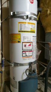 "Water Heater improperly strapped - lower strap should be 4"" from controls - part of making the home safe in an earthquake"