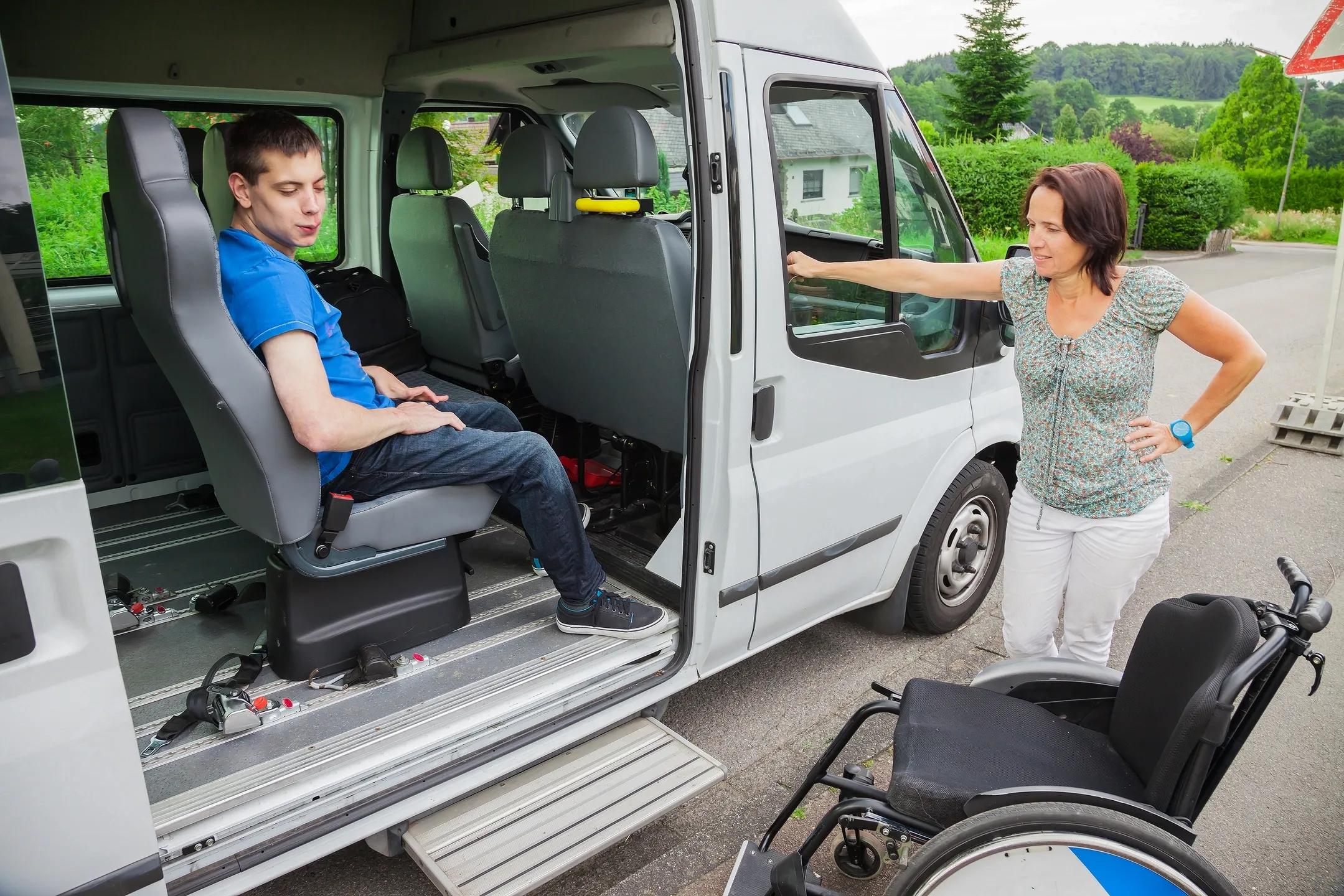 man with wheelchair in van
