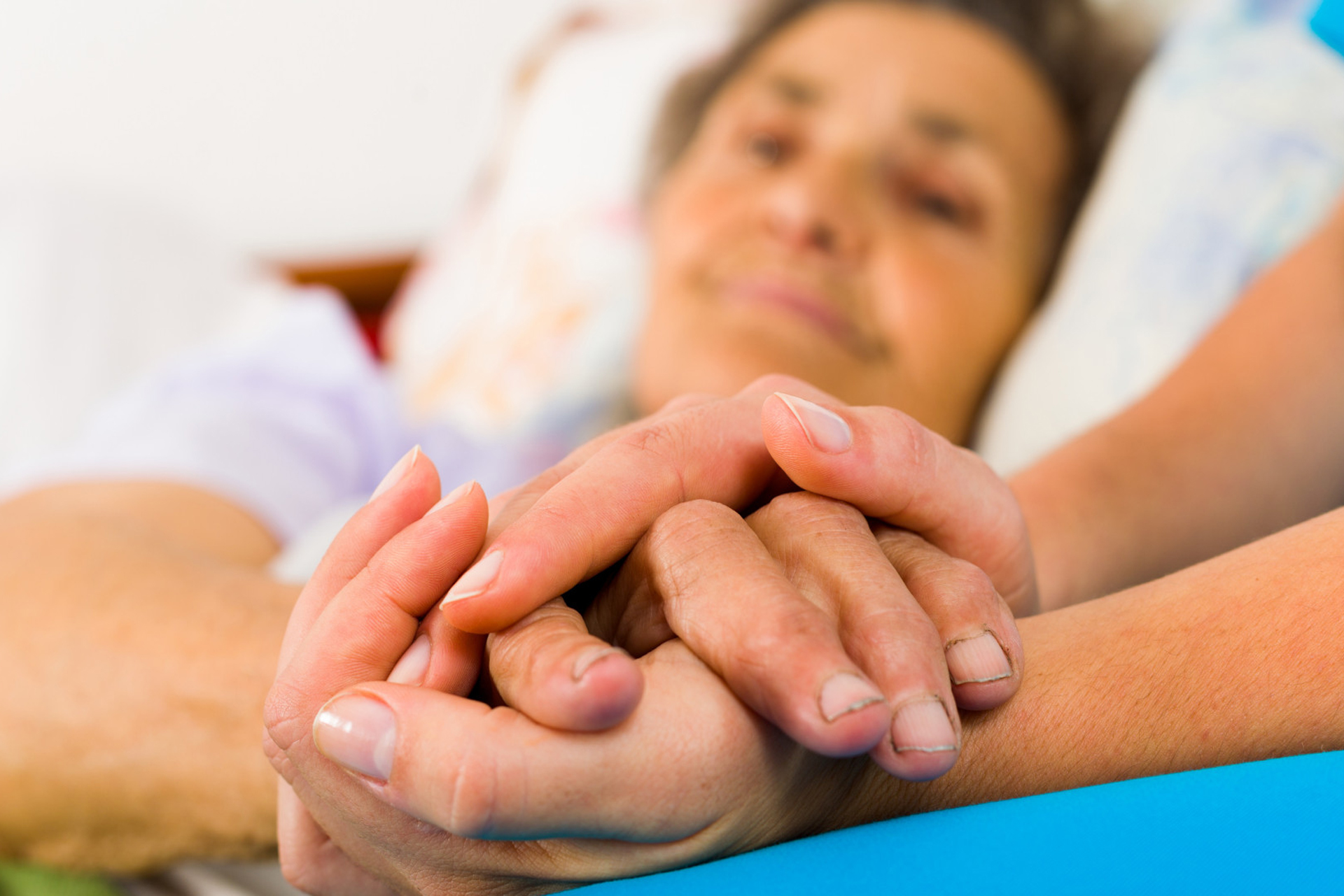 holding hand of patient