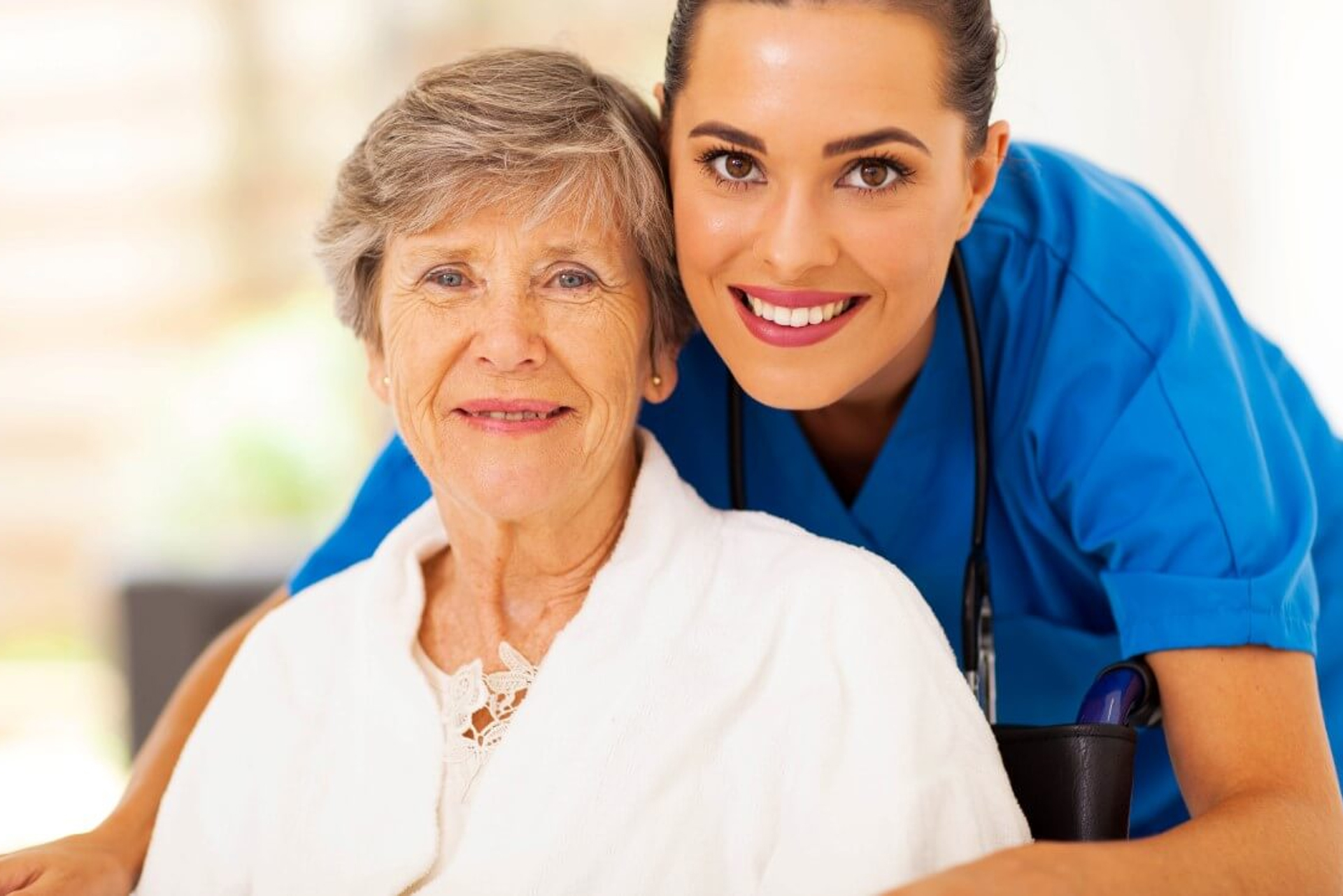 patient in wheelchair with nurse