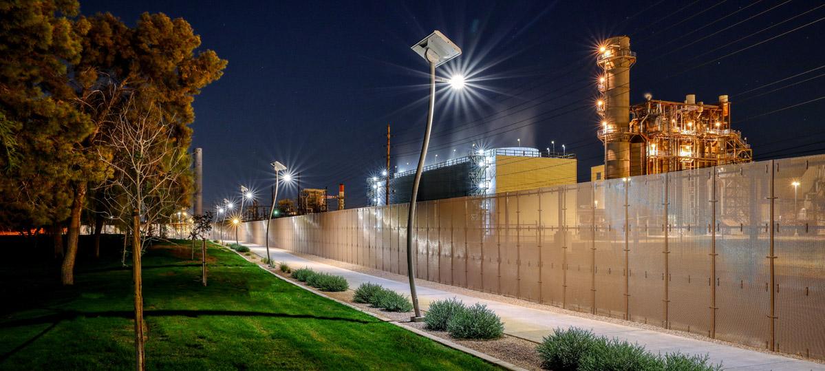 Park lighting along a footpath at night.
