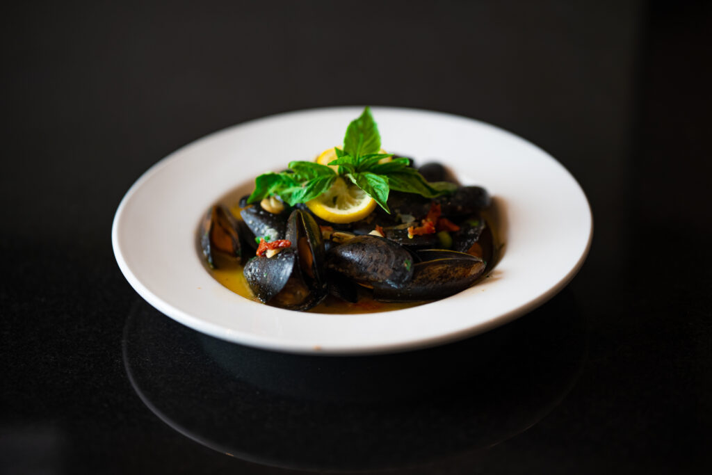 freshly cooked mussels in special sauce by Espositos Pizza Bar and Restaurant