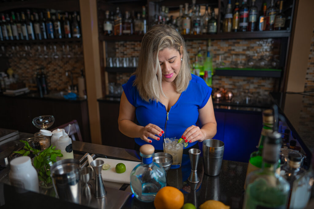 Mixing refreshing cocktail drinks at Espositos Pizza Bar and Restaurant