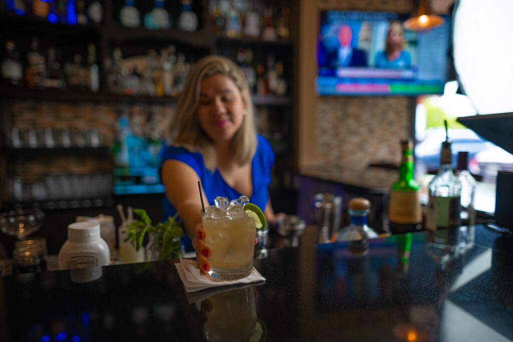 serving refreshing cocktail drinks at Espositos Pizza Bar and Restaurant