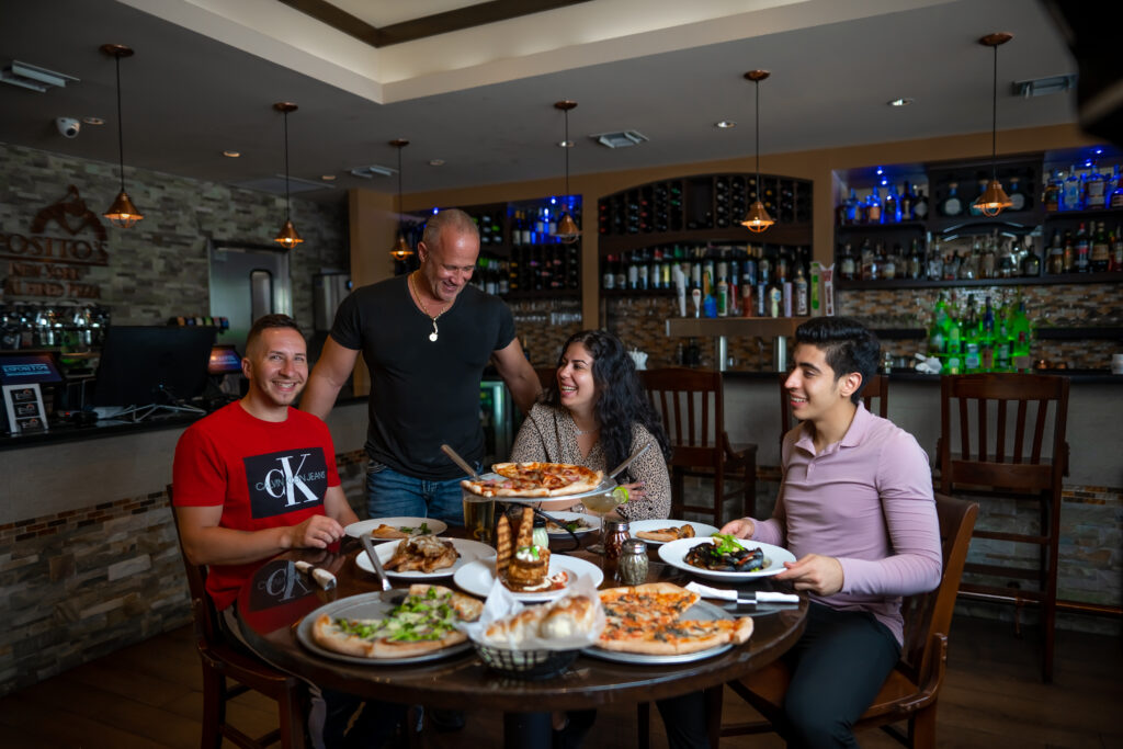 diners enjoying fresh, hand-tossed pizza, bread, entrees, and drinks at Espositos Pizza Bar and Restaurant