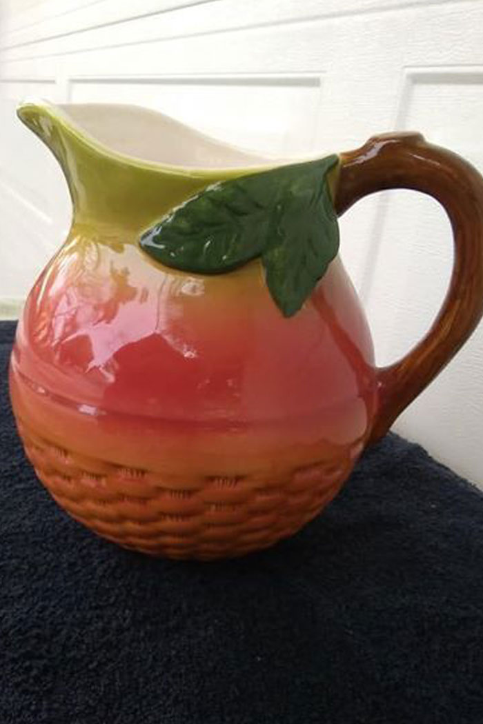 Vintage fruit in a basket pitcher