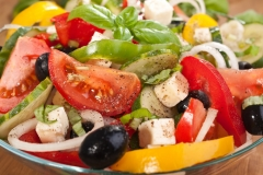 close up healthy greek salad with ingredients