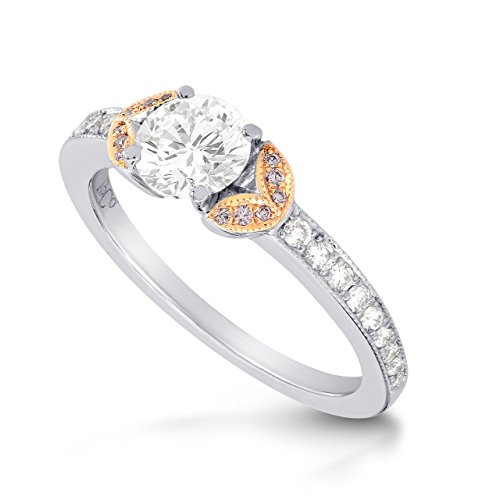 A beautiful 0.90 carats F Round diamond Side Stone Ring Set in 18K White Rose Gold. It comes with an elegant gift box. Manufactured by Leibish and Co.