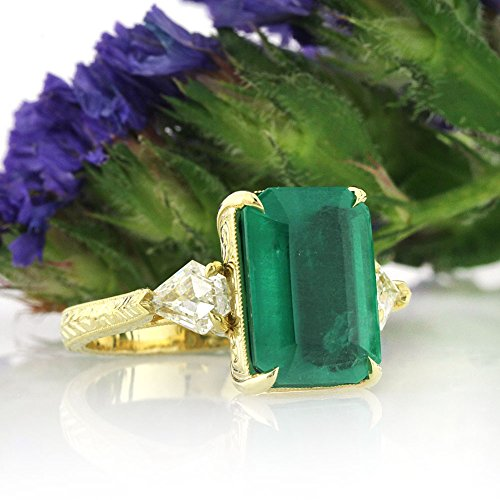 6.35ct Emerald and Diamond Three-Stone Ring
