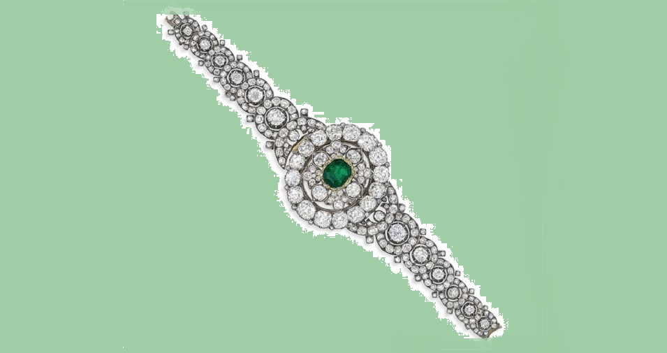 A LATE 19TH CENTURY DIAMOND AND EMERALD BRACELET/BROOCH