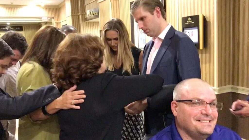 Bonnie Chavda, Donica and others praying with Eric and Lara Trump after Roundtable during the Charlotte Riots