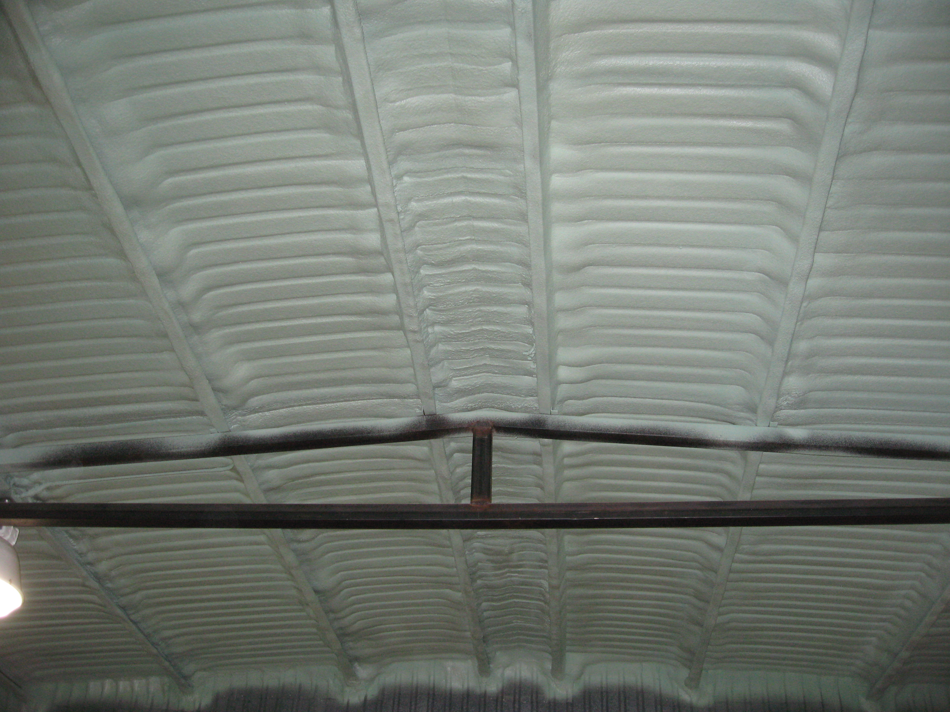 closed cell foam under metal roof