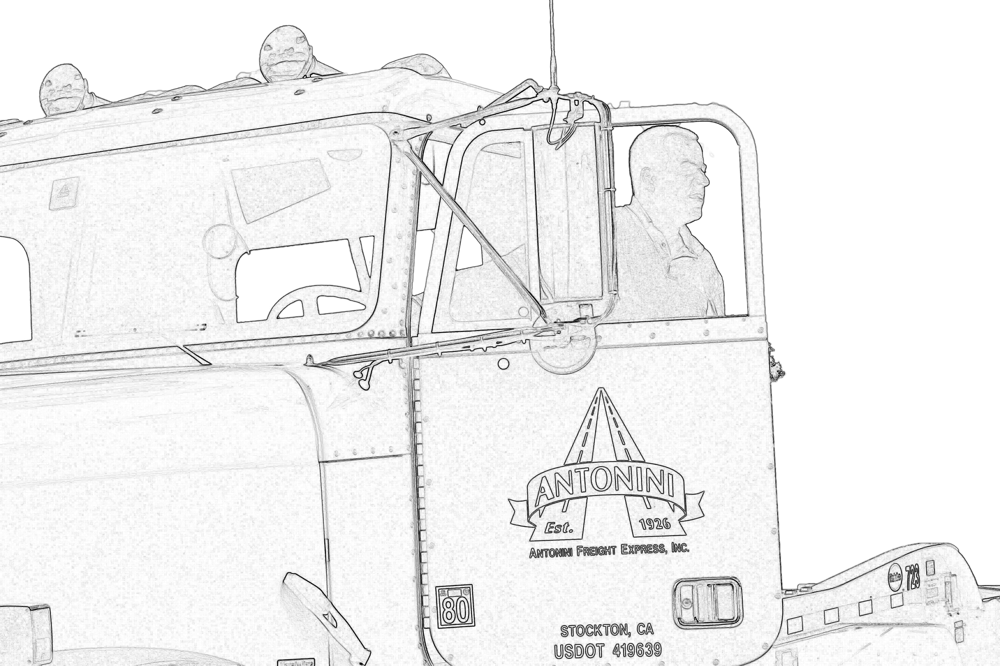 black and white of man standing in the doorway of a semi-truck