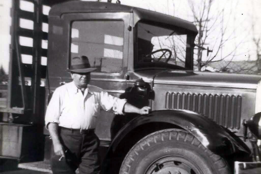 Man with had on 1933 Mack truck