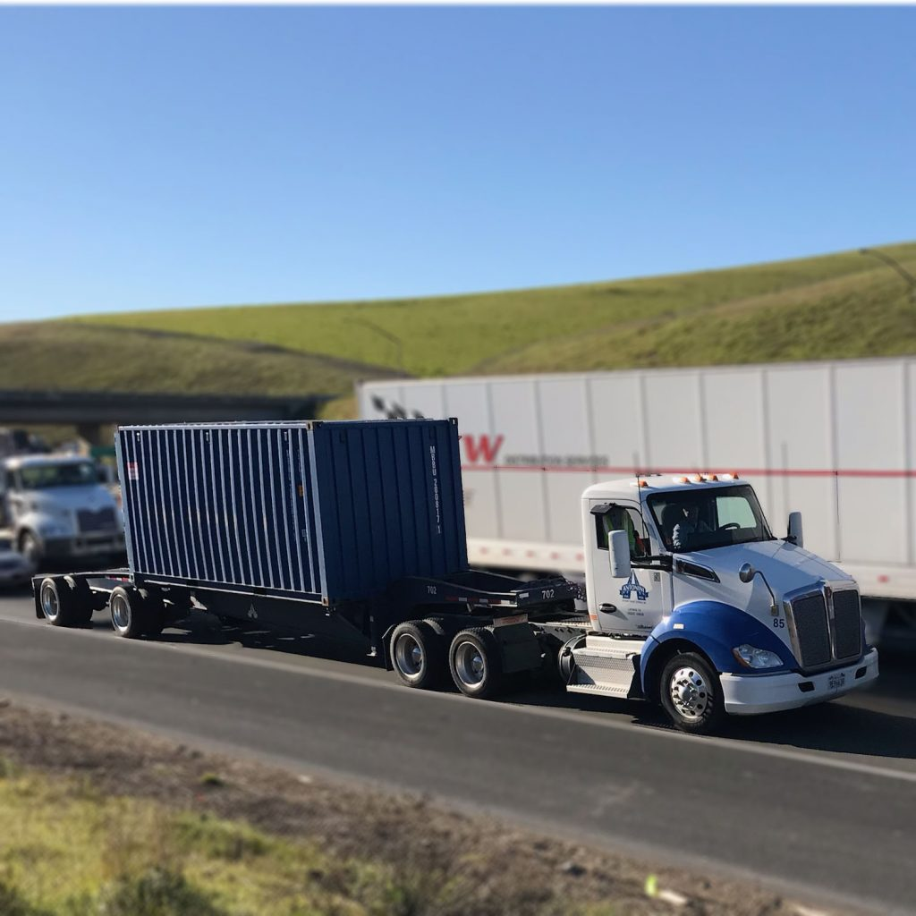 Blue and white kenworth truck container car altamont pass livermore ca