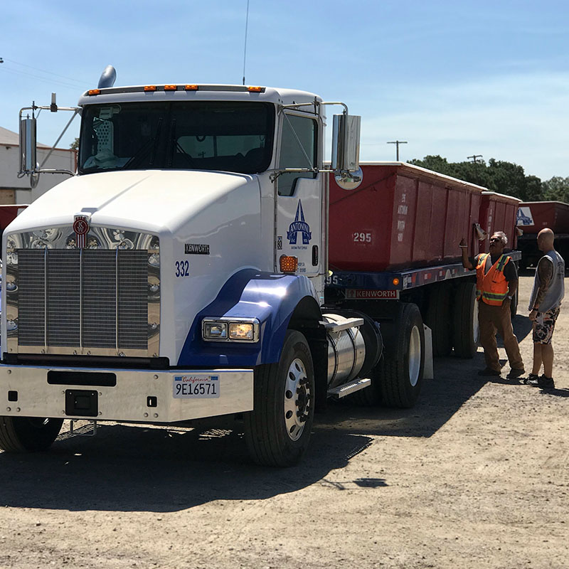 photo of truck driver and safety manager standing next to tomato truck in Modesto, CA