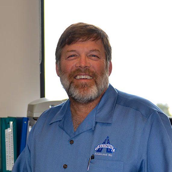 smiling man at Antonini Enterprises