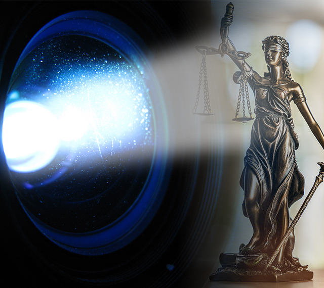 courtroom projector beam over lady of justice statue