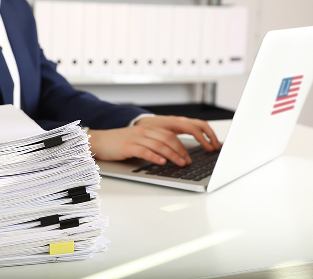 lawyer typing on a laptop entering in document information