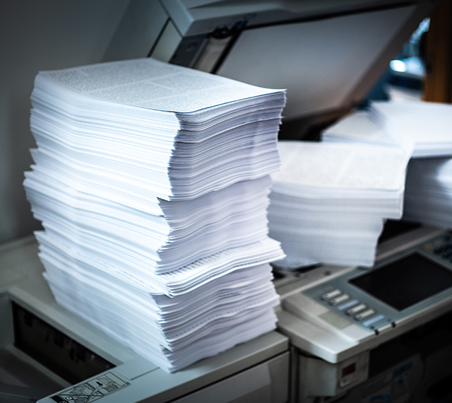 large stack of legal documents on a scanner.