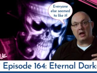 Denis Dyack in front of Eternal Darkness boss