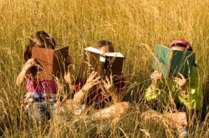 Kids reading in a field