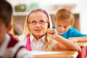 Girl chewing pencil