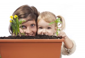 Mother and Young Daughter with Potted Plants