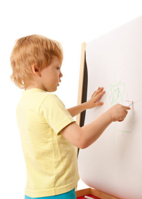 Young Boy Writing On Easel