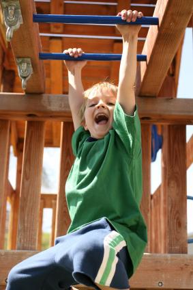Happy Boy On Monkey Bars