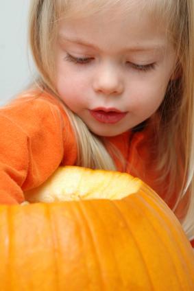 girl carving a pumpkin
