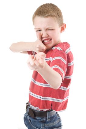 boy pretending to shoot gun