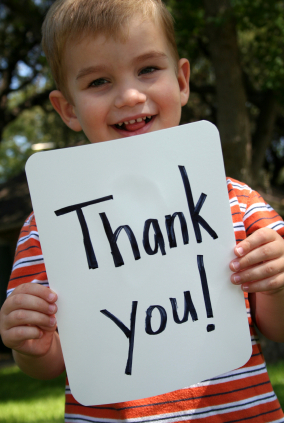 Boy holding a sign saying thank you