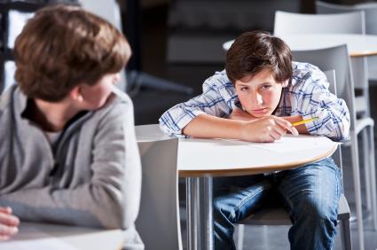bored boy taking a test